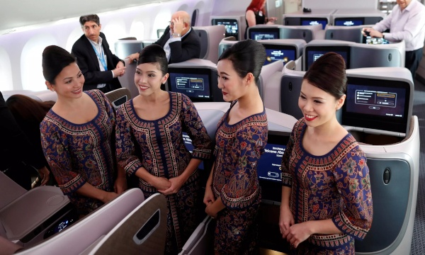 The iconic Singapore Airlines' Singapore Girls pictured here inside a plane cabin.