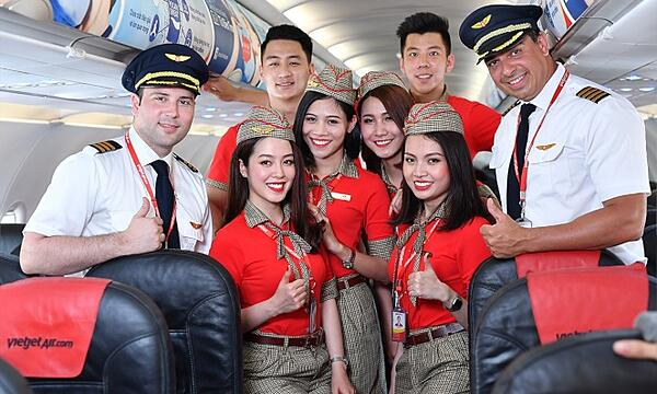 The fun-loving VietJet Air flight crew aboard an airliner.