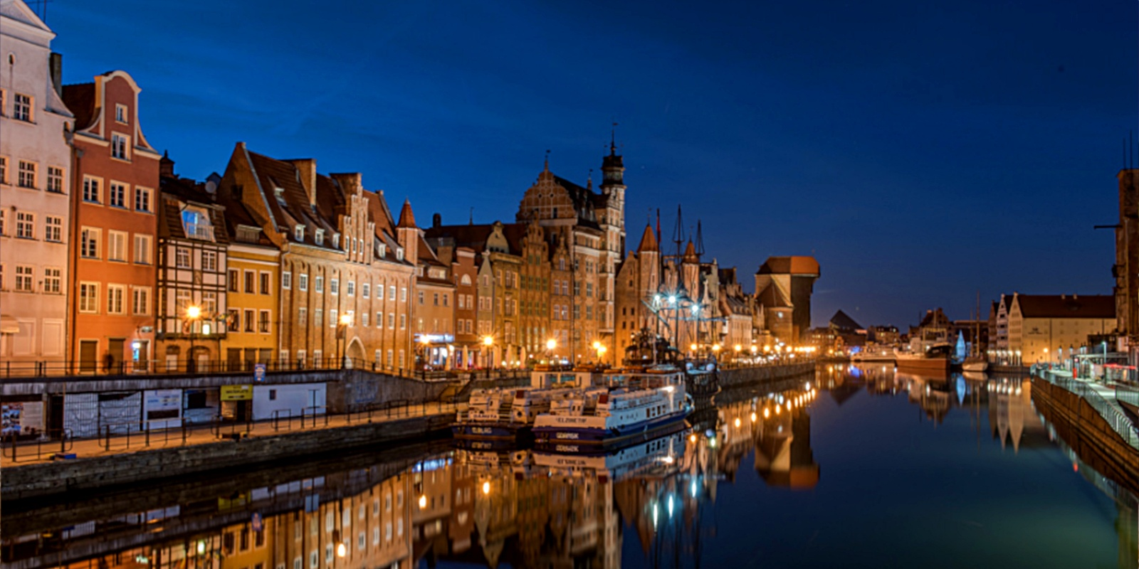 Gdańsk is characterized by its 14th century architectural style, pictured here along the Motława riverside.