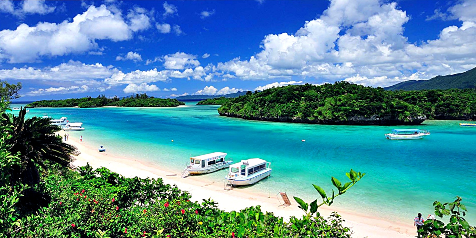 A white sand beach and tropical lagoon in Ishigaki's Kabira Bay.