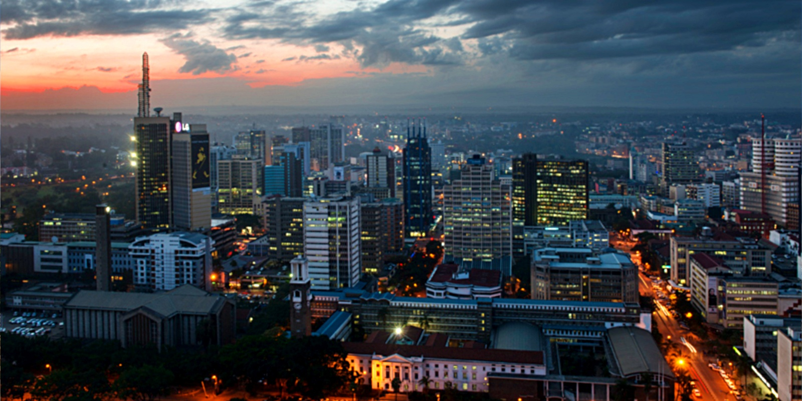 The concrete jungle of Downtown Nairobi at dusk.