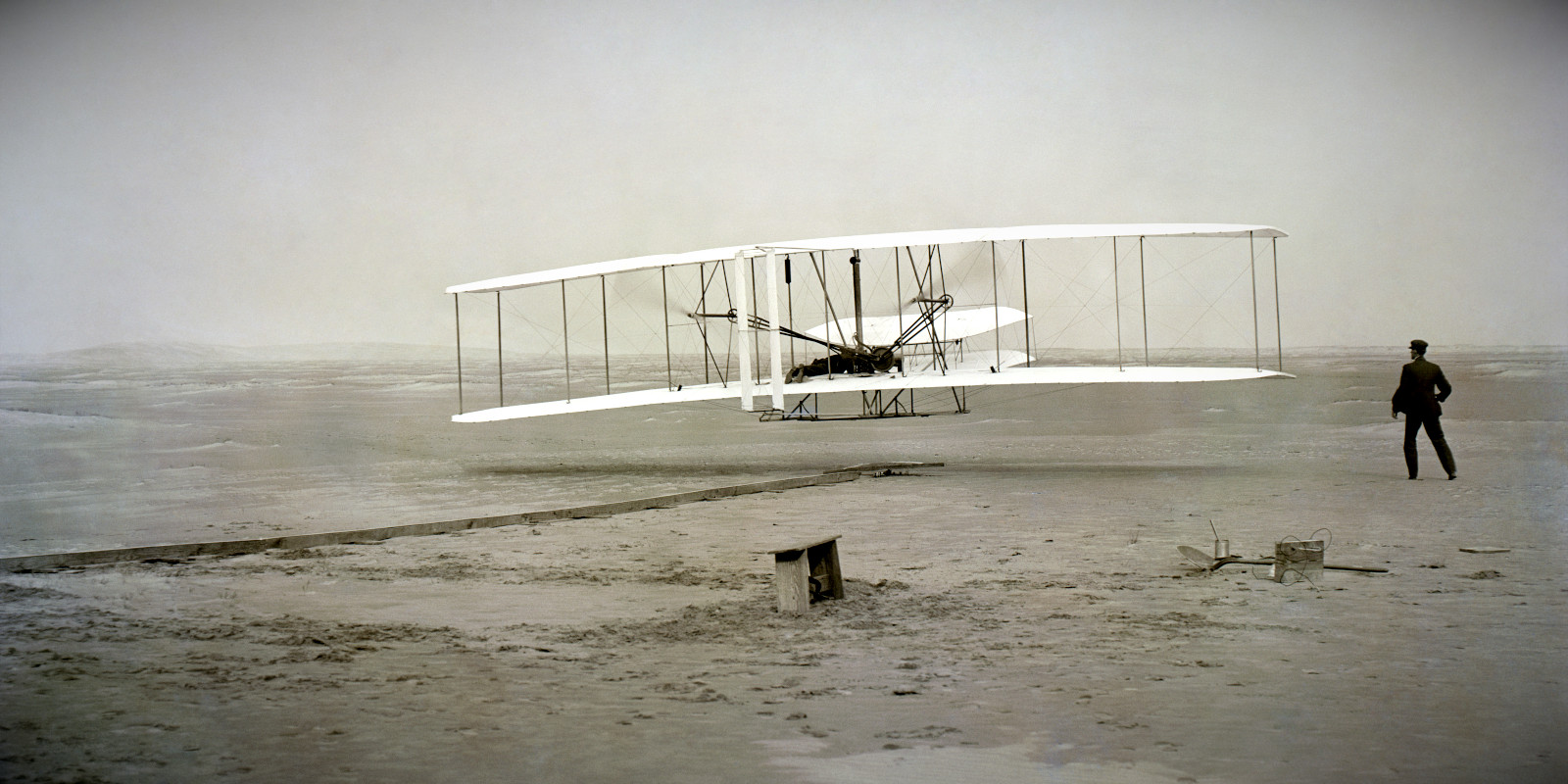 The Wright Brother's Flyer during its first flight in Kitty Hawk.