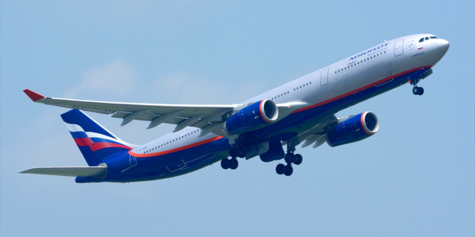 An Aeroflot airliner lifting off into a blue sky.