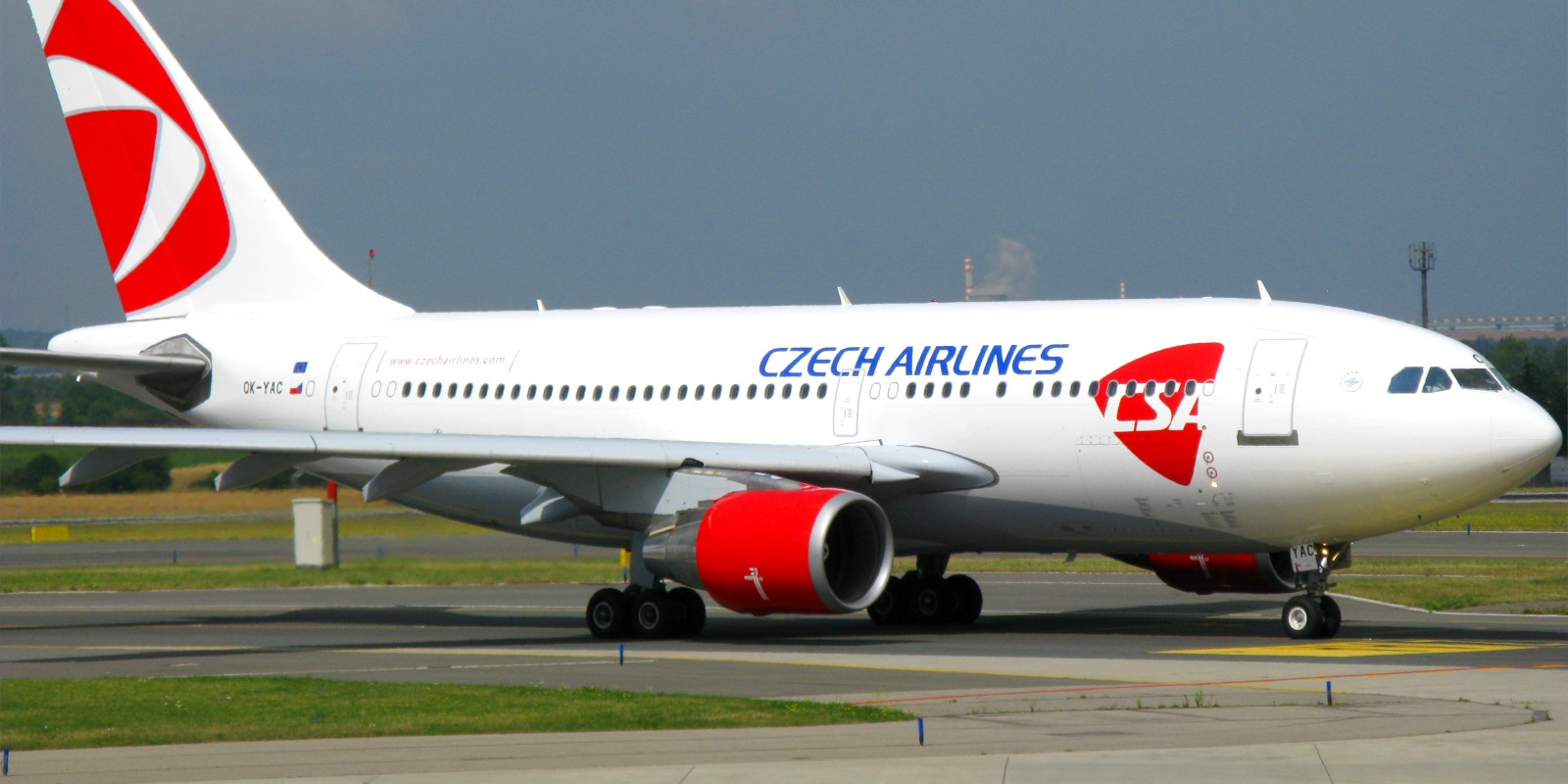A Czech Airlines plane resting on the runway.