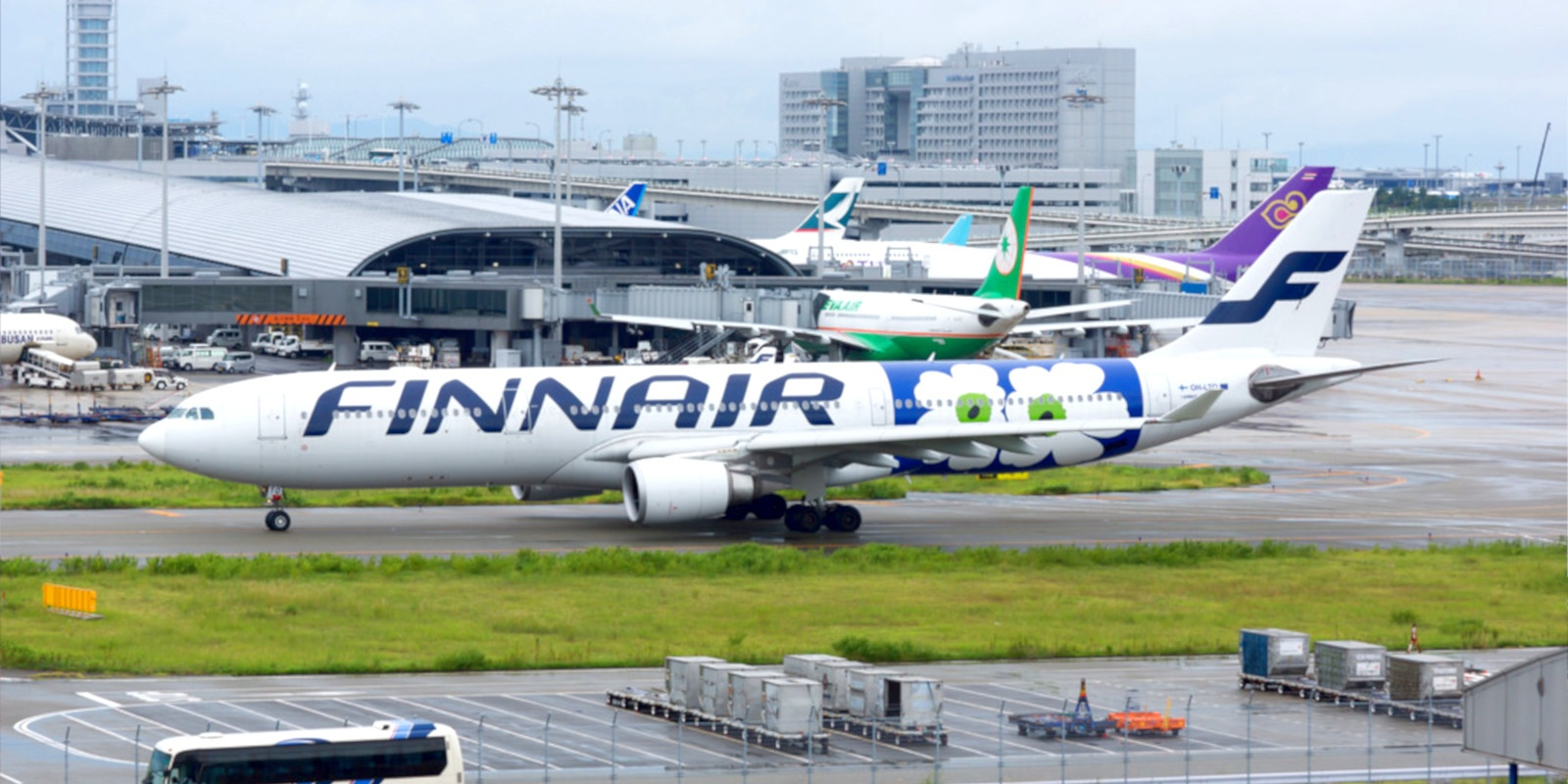 A Finnair airliner resting on the tarmac.