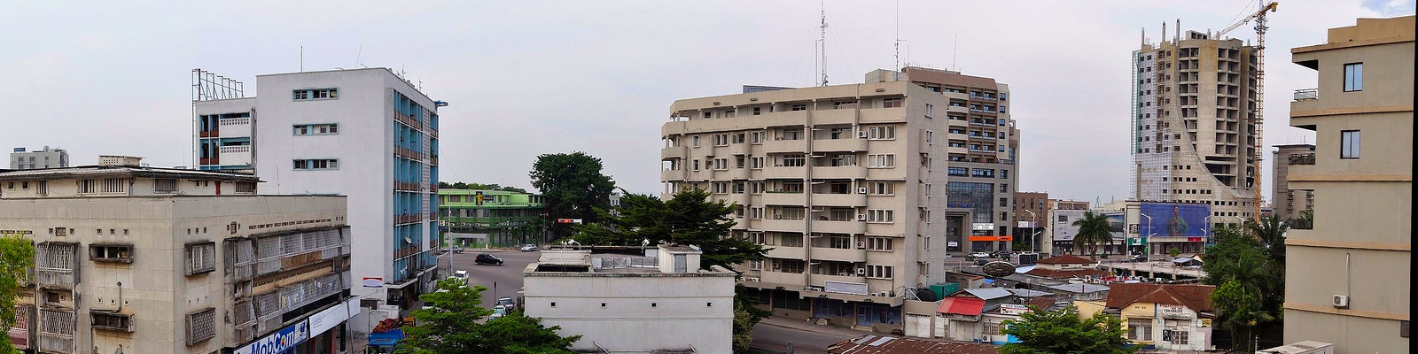 A panoramic view of Kinshasa city streets and buildings.